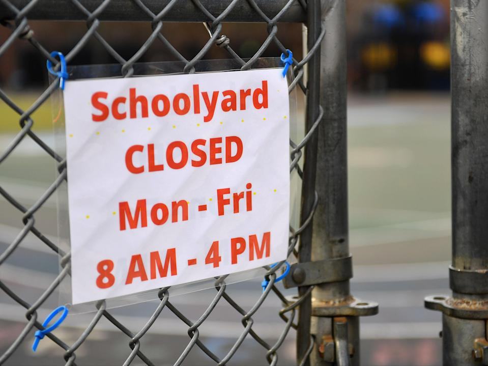 A schoolyard is closed outside a public school in the Brooklyn borough of New York City on 19 November 2020 ((AFP via Getty Images))