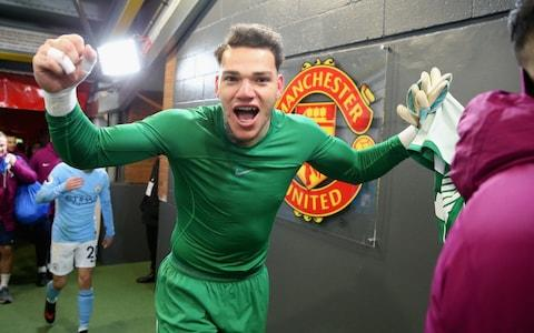 Ederson of Manchester City celebrates after their win against Manchester United - Credit: Getty