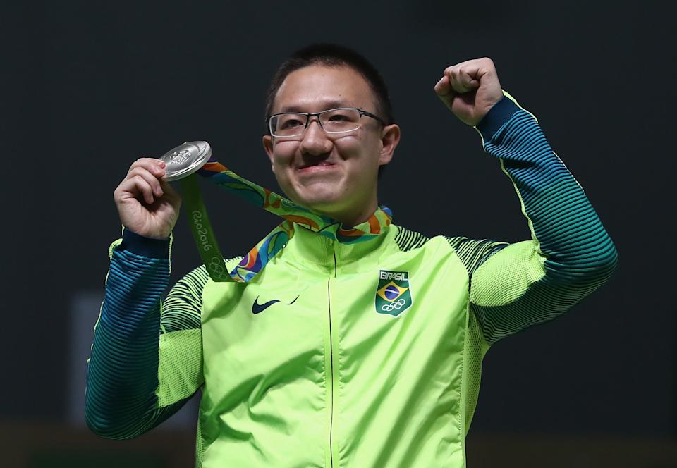 RIO DE JANEIRO, BRAZIL - AUGUST 06:  Felipe Almeida Wu of Brazil celebrates after winning the silver medal in the 10m Air Pistol Men's Finals on Day 1 of the Rio 2016 Olympic Games at the Olympic Shooting Centre on August 6, 2016 in Rio de Janeiro, Brazil.  (Photo by Sam Greenwood/Getty Images)
