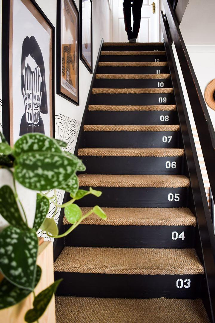 """<p>""""These stairs were originally carpeted and the bannisters painted a dark brown. As this staircase is actually in my living room, I wanted it to look more like a feature rather than an eyesore. I painted risers with <a href=""""https://www.valsparpaint.co.uk/colours/pre-selected-colours/blacks/coal-tipple/"""" rel=""""nofollow noopener"""" target=""""_blank"""" data-ylk=""""slk:Valspar Coal Tipple"""" class=""""link rapid-noclick-resp"""">Valspar Coal Tipple</a> and carpeted the steps.""""</p>"""