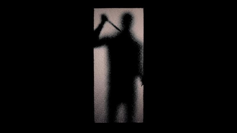 Fearful silhouette of man with knife standing near glass door maniac breaking in (Photo: Motortion via Getty Images)