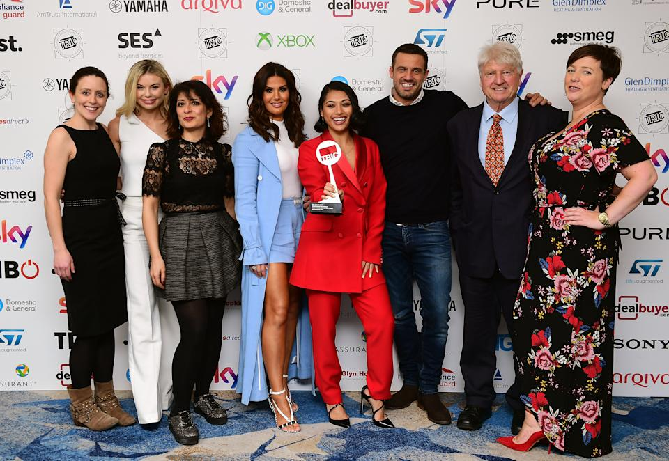 Shappi Khorsandi (third left), Rebekah Vardy (centre left), Vanessa White (centre right), Jamie Lomas (third right), Stanley Johnson (second right) and Georgia Toffolo (second left) with the award for Entertainment Programme Award Sponsored by Sony for I'm A Celebrity Get Me Out Of Here during the 2018 TRIC Awards at the Grosvenor House Hotel, London. (Photo by Ian West/PA Images via Getty Images)