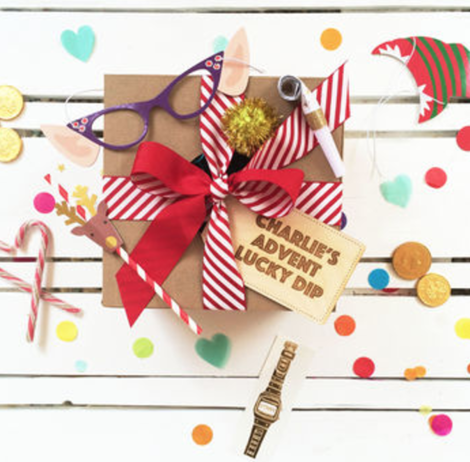 """<p>Celebrate the countdown to Christmas a little differently this year with a personalised lucky dip advent calendar in a Box! Bursting with 24 surprises, one for each day of advent. Each box is filled with heaps of colourful confetti, streamers and prizes, suitable for both children and adults, male or female.<br></p><p>£35 <a href=""""http://www.notonthehighstreet.com/postboxparty/product/christmas-lucky-dip-advent-surprise-gift-box"""" rel=""""nofollow noopener"""" target=""""_blank"""" data-ylk=""""slk:Not On The High Street"""" class=""""link rapid-noclick-resp"""">Not On The High Street</a></p>"""
