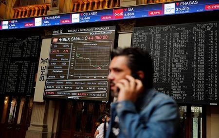 A man talks on a phone at the Madrid stock exchange which plummeted after Britain voted to leave the European Union in the EU BREXIT referendum, in Madrid