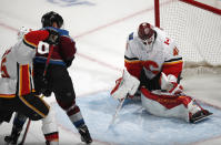 Calgary Flames goaltender Mike Smith, right, makes a glove save of a shot by Colorado Avalanche right wing Mikko Rantanen, center, as Calgarys Mark Giordano defends during the third period of Game 4 of an NHL hockey playoff series Wednesday, April 17, 2019, in Denver. The Avalanche won 3-2 in overtime. (AP Photo/David Zalubowski)