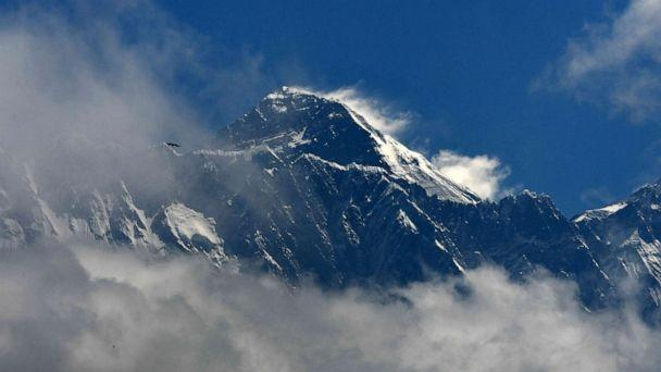PHOTO: In this May 27, 2019, file photo, Mount Everest appears amidst the clouds. (Prakash Mathema/AFP/Getty Images, FILE)