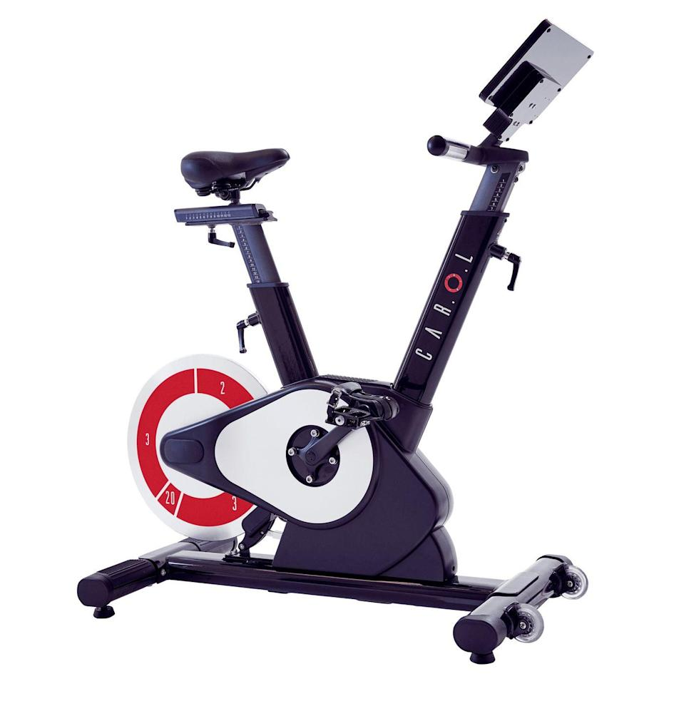 "<p><strong><em>CAR.O.L Exercise Bike</em></strong><br><em>$2,995 + $12/month, <a href=""https://shop.carolfitai.com/usa/"" rel=""nofollow noopener"" target=""_blank"" data-ylk=""slk:carolfitai.com"" class=""link rapid-noclick-resp"">carolfitai.com</a></em><br><a class=""link rapid-noclick-resp"" href=""https://shop.carolfitai.com/usa/"" rel=""nofollow noopener"" target=""_blank"" data-ylk=""slk:Buy"">Buy</a></p><p>CAR.O.L is a high-intensity training workout bike that kicks my ass every day. I was skeptical of the whole HIIT promise to lower my daily workout time, but those qualms are long gone. This bike uses short sprints and cool-downs to make your workout quick, and it even has a 10-minute option that helps you avoid sweating. It's not easy by any means; the number of f-bombs I've dropped using this bike is unparalleled. I switch between the fat burning 10-minute and 20-minutes cycles, and both make me feel like I've sprinted three miles, even though I'm not drenched in sweat. The weight loss aspect has worked for me, and the fast boot-up and minimal time commitment make it a very easy morning or evening ritual to keep up with. The bike also features a normal mode, where you can use it like any other exercise bike. Now, this bike is a financial commitment and may not be in the cards for everyone, but if you've been looking for a different machine, this is a wild addition to a home gym.<br></p>"