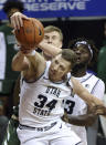 Utah State forward Justin Bean (34) and Colorado State forward James Moors (10) reach for a rebound during the first half of an NCAA college basketball game in the semifinals of the Mountain West Conference men's tournament Friday, March 12, 2021, in Las Vegas. (AP Photo/Isaac Brekken)