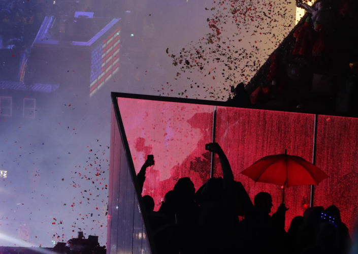 Confetti drops over the crowd as the clock strikes midnight during the New Year's Eve celebration in Times Square as seen from the Marriott Marquis. (Photo: Frank Franklin II/AP)