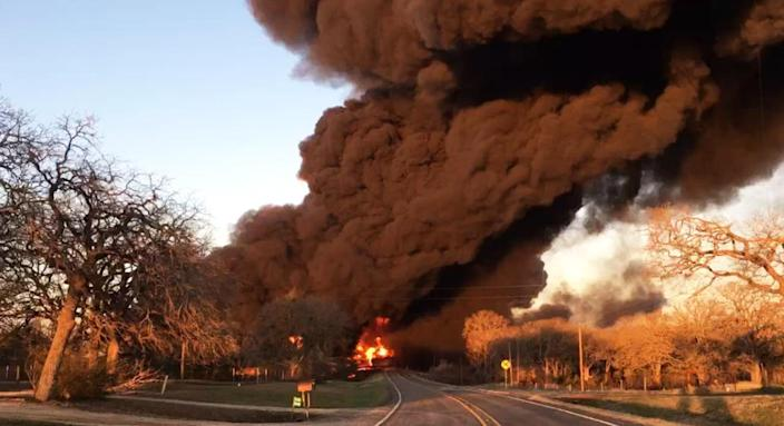 Smoke billows from a fire following an explosion caused by a crash between a train and an 18-wheeler near Cameron, Texas, on Feb. 23, 2021. (Milam County Sheriff Chris White)