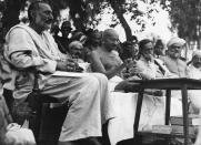 Mahatma Gandhi flanked by the Reverend Dalaya and Khan Abdul Ghaffar Khan during a speech to students at King Edward's College, Peshawar in 1933. | Location: King Edward's College, Peshawar, India. (Photo by © Hulton-Deutsch Collection/CORBIS/Corbis via Getty Images)