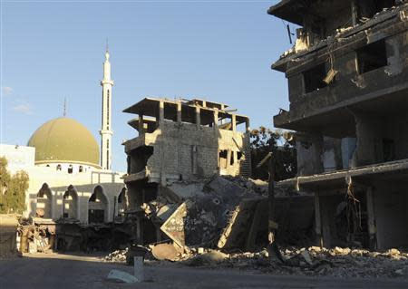 A view of damaged buildings in the Damascus suburb of Zamalka