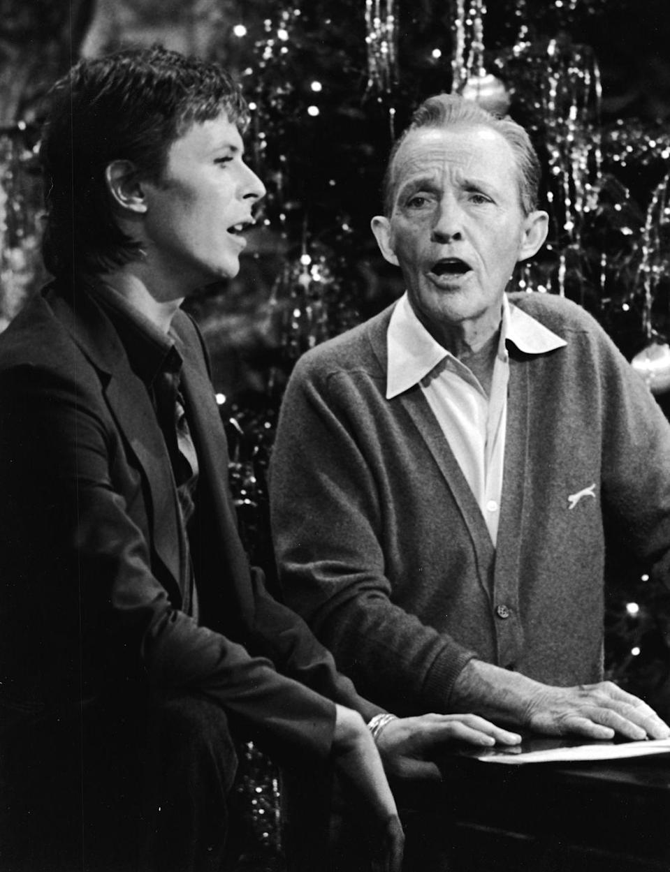<p>Two generations of legends collided when David Bowie performed with Bing Crosby for <em>Bing Crosby's Merrie Olde Christmas</em> TV special. Bowie pared down from his typical Ziggy Stardust costumes, wearing a dark sport coat and button-down.  </p>