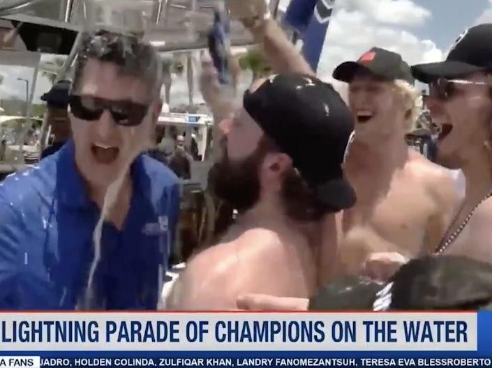 A still image from a video showing Tampa Bay Lightning right winger Nikita Kucherov dumping his drink on a WFLA.com reporter's head while was interviewed at a boat parade.