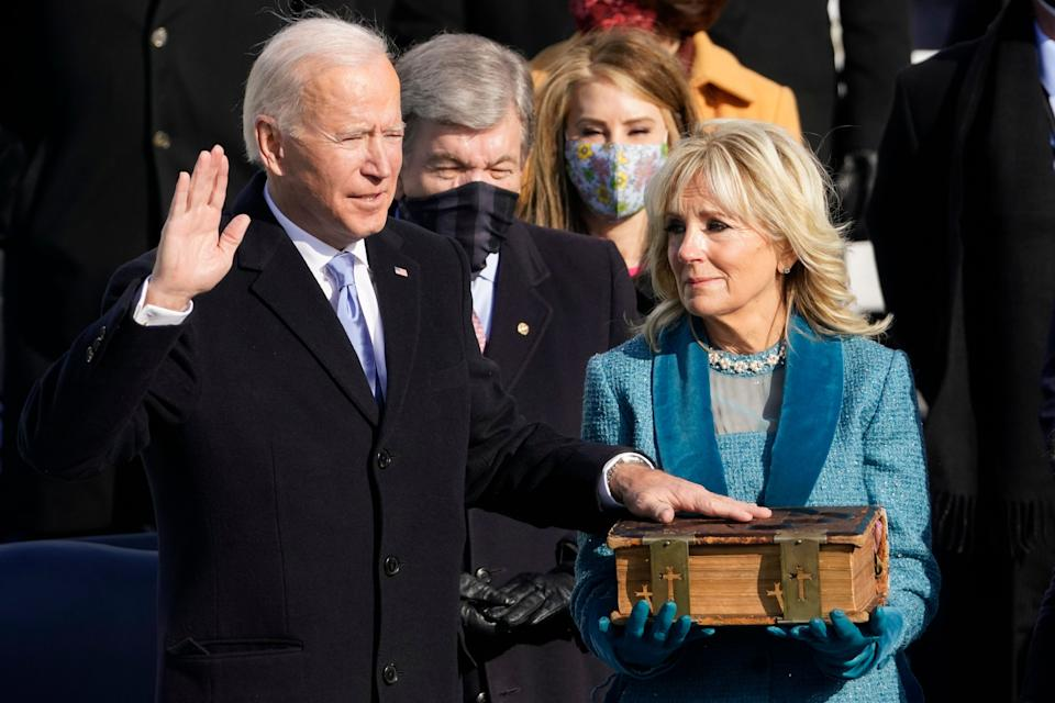 Joe Biden is sworn in as the 46th president of the United States as Jill Biden holds the Bible at the U.S. Capitol on Jan. 20, 2021. (Photo: AP Photo/Andrew Harnik)