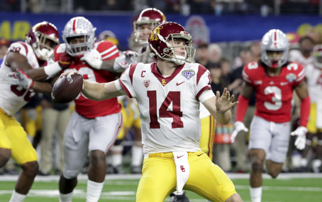 "Southern California quarterback <a class=""link rapid-noclick-resp"" href=""/ncaaf/players/255254/"" data-ylk=""slk:Sam Darnold"">Sam Darnold</a> (14) throws a pass with teammates providing blocking against Ohio State during the first half of the Cotton Bowl NCAA college football game in Arlington, Texas, Friday, Dec. 29, 2017. (AP Photo/LM Otero)"