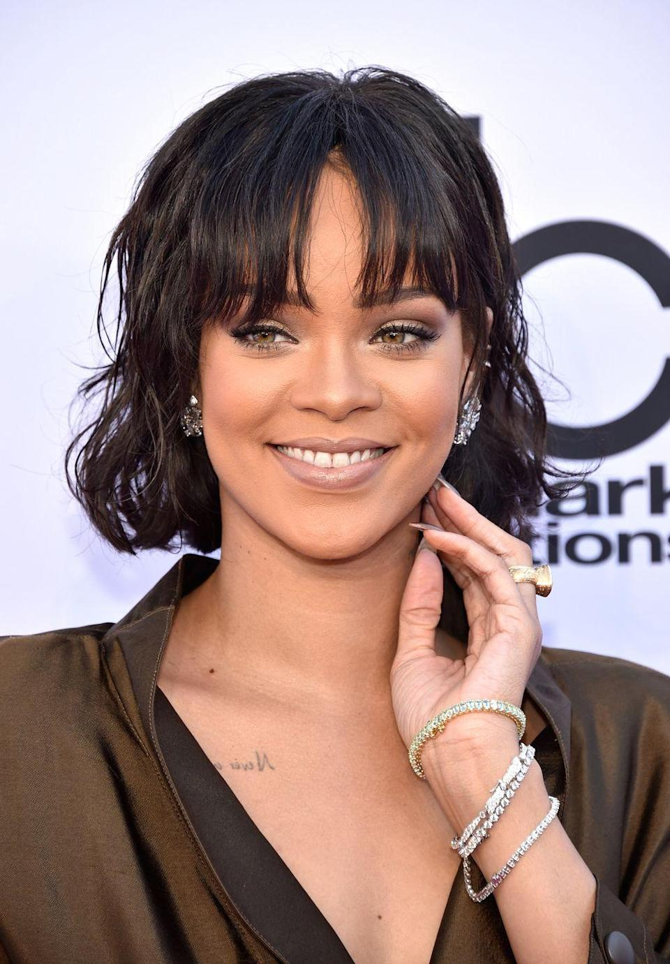 <p>Rihanna is constantly changing her hair – her oval face shape means she suits most hairstyles. This fringe is the thing that stops her new lob from being mumsy. </p>