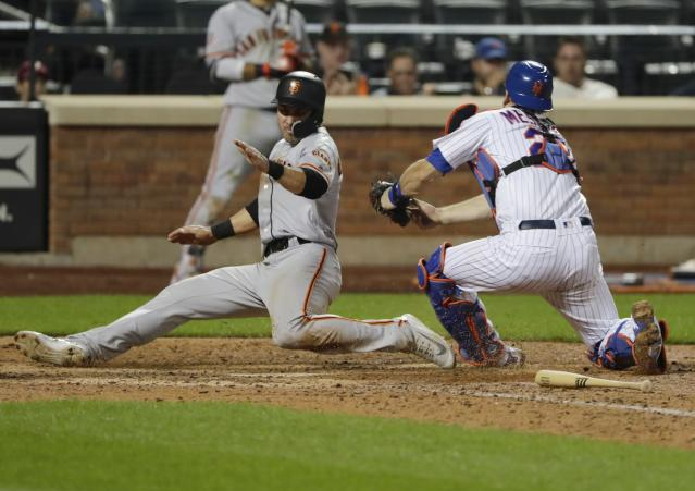 San Francisco Giants' Chase d'Arnaud, left, slides past New York Mets catcher Devin Mesoraco during the thirteenth inning of a baseball game Monday, Aug. 20, 2018, in New York. d'Arnaud was tagged out after missing the plate. The Giants won 2-1. (AP Photo/Frank Franklin II)