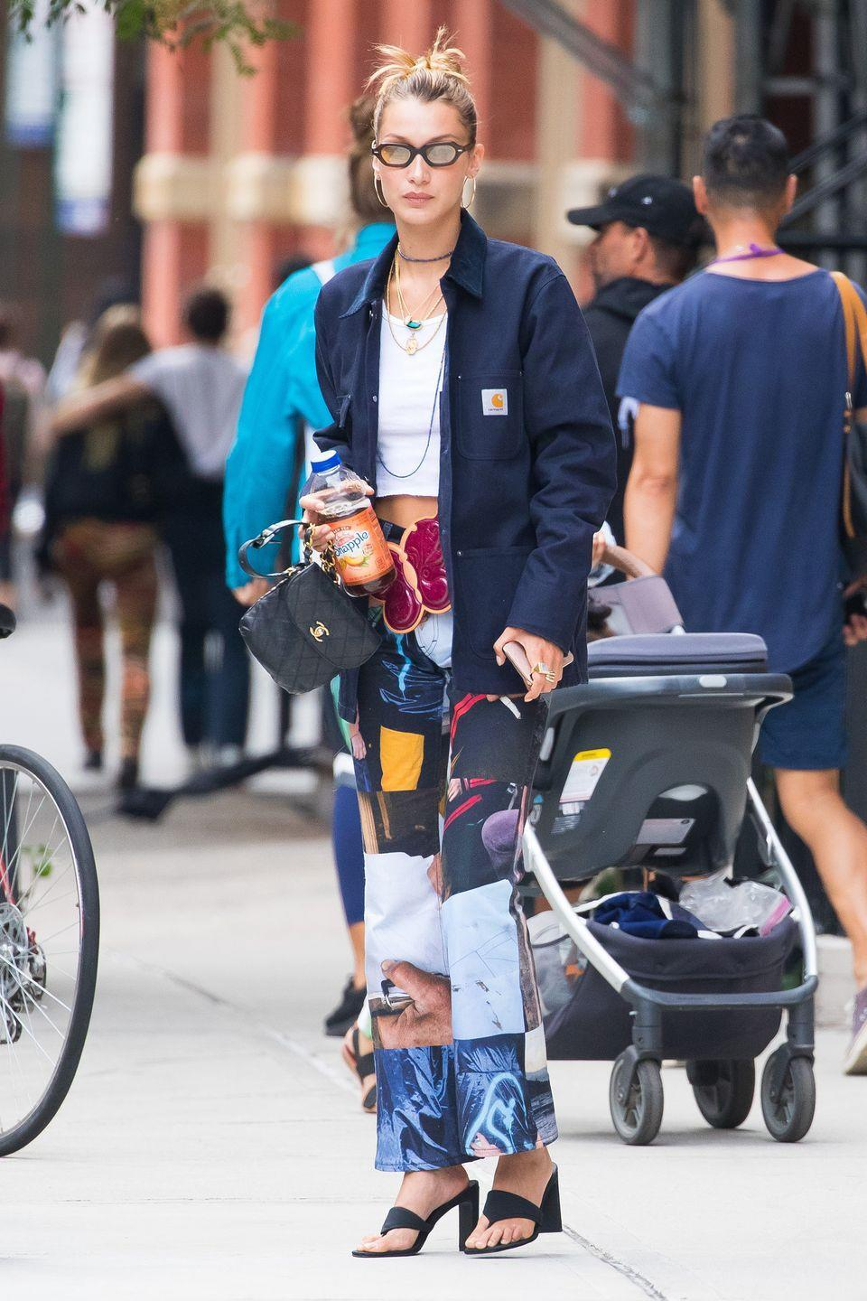 """<p>In a white crop top, navy blue Carhartt button-down, patterned pants, a mini Chanel bag, Mercii's <a href=""""https://www.mercii.com/collections/new-collection/products/dusk-till-dawn-pendant"""" rel=""""nofollow noopener"""" target=""""_blank"""" data-ylk=""""slk:Dusk till Dawn"""" class=""""link rapid-noclick-resp"""">Dusk till Dawn</a> necklace, shades, and Bevza black heeled sandals.</p>"""