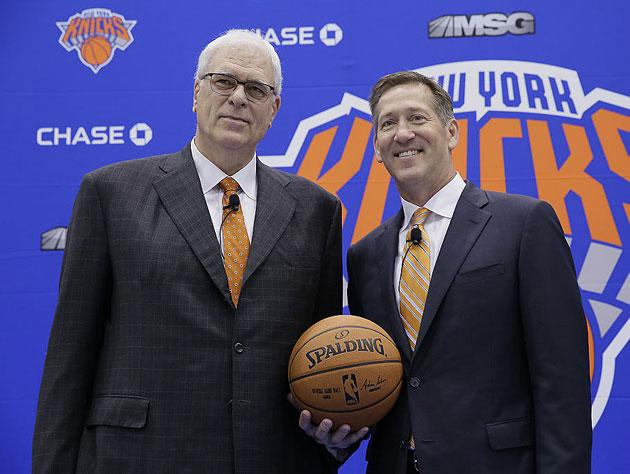Phil Jackson and Jeff Hornacek stand tall. (Getty Images)