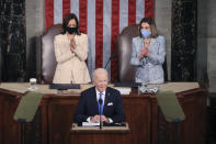 President Joe Biden arrives to address a joint session of Congress, Wednesday, April 28, 2021, in the House Chamber at the U.S. Capitol in Washington, as Vice President Kamala Harris, left, and House Speaker Nancy Pelosi of Calif., look on. (Chip Somodevilla/Pool via AP)