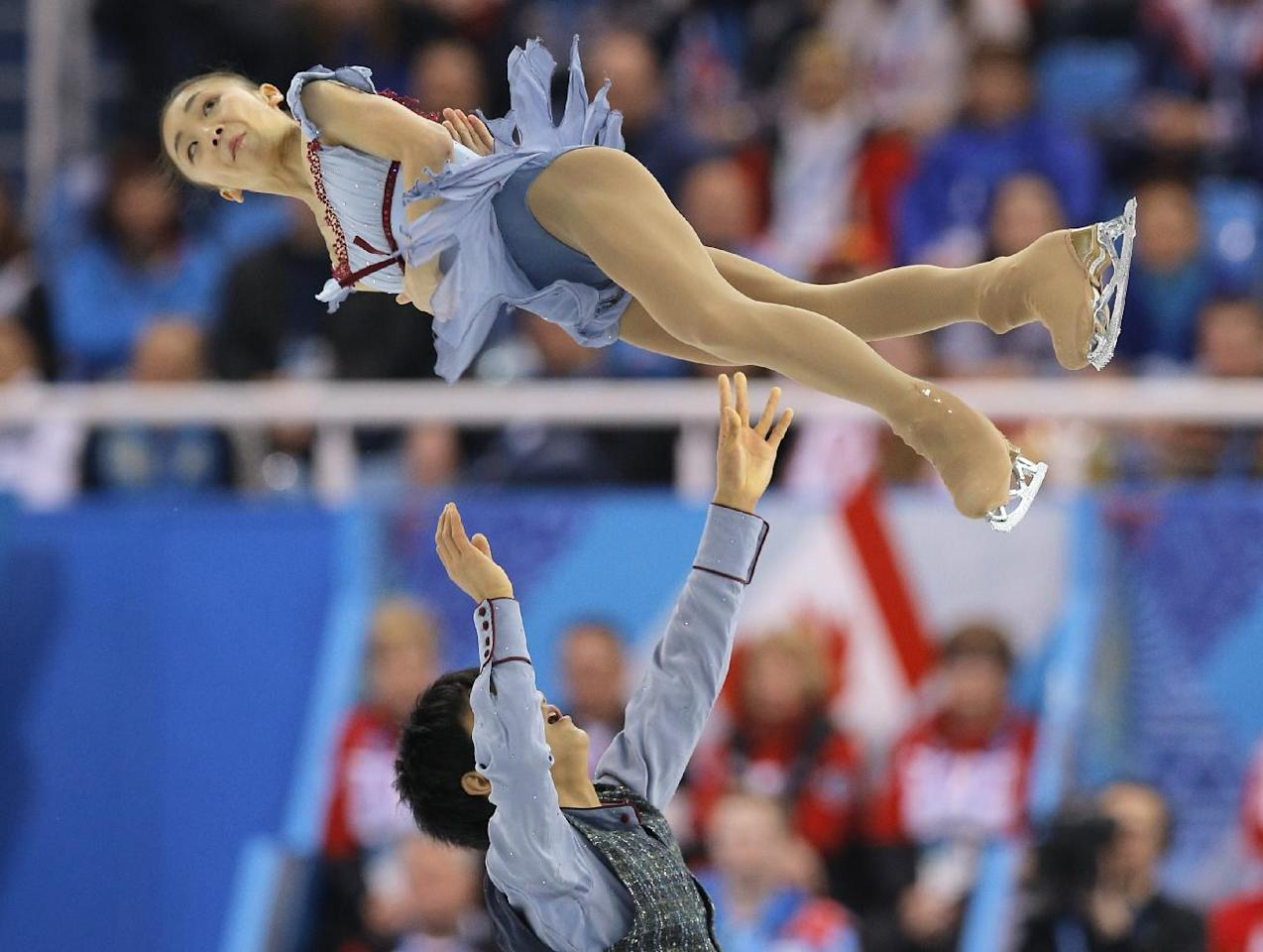 Narumi Takahashi and Ryuichi Kihara of Japan compete in the team pairs free skate figure skating competition at the Iceberg Skating Palace during the 2014 Winter Olympics, Saturday, Feb. 8, 2014, in Sochi, Russia. (AP Photo/Vadim Ghirda)
