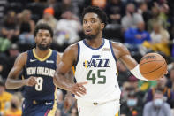 Utah Jazz guard Donovan Mitchell (45) brings the ball upcourt in the second half of a preseason NBA basketball game against the New Orleans Pelicans, Monday, Oct. 11, 2021, in Salt Lake City. (AP Photo/Rick Bowmer)