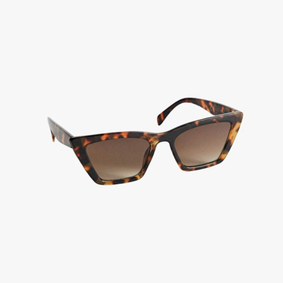 """& Other Stories is offering up to 50% off on select items this weekend. $29, & OTHER STORIES. <a href=""""https://www.stories.com/en_usd/accessories/sunglasses/cat-eye/product.angular-cat-eye-sunglasses-beige.0742470006.html"""" rel=""""nofollow noopener"""" target=""""_blank"""" data-ylk=""""slk:Get it now!"""" class=""""link rapid-noclick-resp"""">Get it now!</a>"""