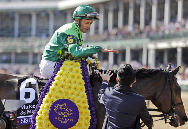 John Velazquez celebrates after riding Sistercharlie to victory in the Breeders' Cup horse race Filly and Mare Turf at Churchill Downs, Saturday, Nov. 3, 2018, in Louisville, Ky. (AP Photo/Darron Cummings)