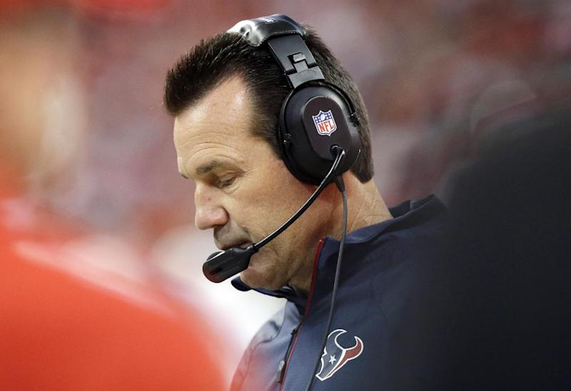 FILE - In this Nov. 3, 2013 file photo, Houston Texans head coach Gary Kubiak watches from the sidelines during the first quarter of an NFL football game against the Indianapolis Colts, in Houston. The Texans have fired coach Kubiak. The team announced the decision Friday, Dec. 6, 2013, one day after the Texans lost their 11th straight game, 27-20 at Jacksonville. (AP Photo/Patric Schneider, File)