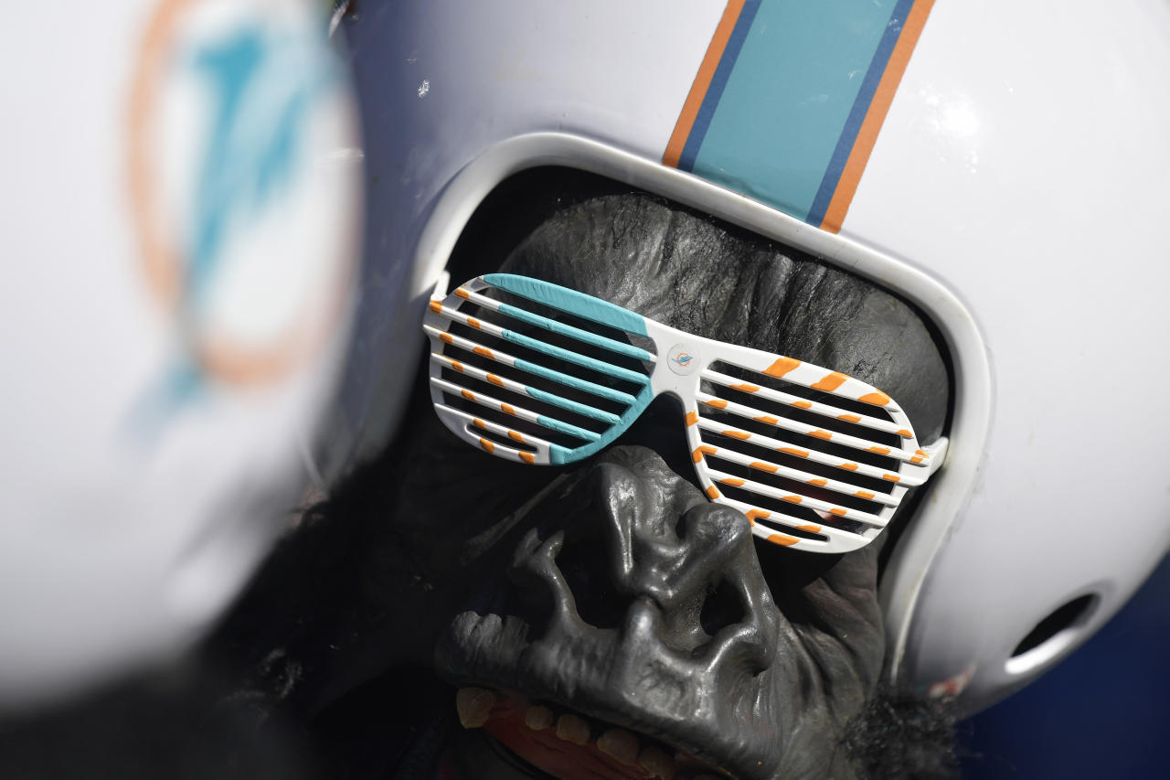 Miami Dolphins fans converse near the main stage ahead of the second round of the NFL football draft, Friday, April 26, 2019, in Nashville, Tenn. (AP Photo/Mike Stewart)