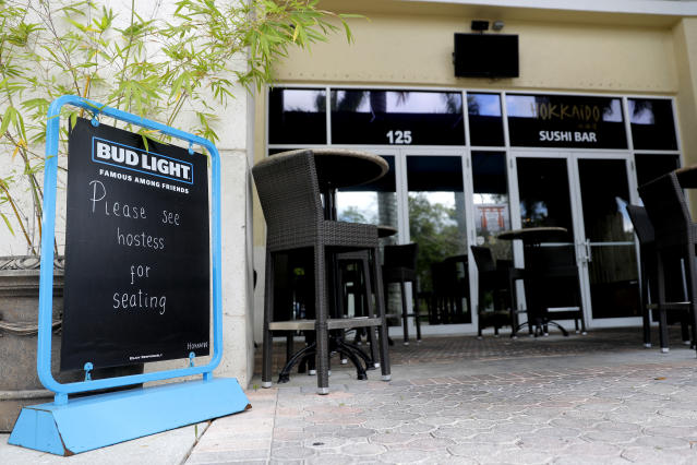 A sign is placed at a deserted at Hokkaido sushi bar, Monday, March 16, 2020, in Jupiter, Fla. The restaurant, which is across the street from Roger Dean Chevrolet Stadium, the spring training baseball home of the St. Louis Cardinals and the Miami Marlins, is normally full with customers on game day. On Sunday night, the Centers for Disease Control and Prevention recommended gatherings of 50 people or more be canceled or postponed across the country for the next eight weeks. Major League Baseball planned to update teams Monday on its health policy. (AP Photo/Julio Cortez)