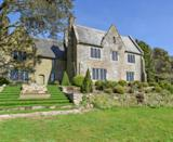 """<p>A former Victorian vicarage, Trenoweth House is packed with character and a fabulous spot for a group getaway. The Airbnb in Cornwall sits within acres of farmland, with woodland, natural swimming lakes and streams surrounding it. Aside from its rural seclusion, this pad has been beautifully restored to blend its original features with modern design. </p><p>You'll find large granite walls, open fireplaces and exposed beams intertwined with sleek architecture, including the kitchen with its glass ceiling and wood fired pizza oven. The garden views are sensational and there are four-poster beds, roll top baths and a large dining space to make use of.<strong><br></strong></p><p><strong>Sleeps</strong>: 14</p><p><strong>Price per night:</strong> £463</p><p><strong>Why we love it:</strong> It's just a short drive from Cornwall's beaches but offers a peaceful retreat in the country when you want to escape from the outside world.</p><p><a class=""""link rapid-noclick-resp"""" href=""""https://www.airbnb.co.uk/rooms/37941940?source_impression_id=p3_1592809915_ez318jmX009edfAG"""" rel=""""nofollow noopener"""" target=""""_blank"""" data-ylk=""""slk:SEE INSIDE"""">SEE INSIDE</a></p>"""