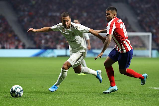 Eden Hazard (left) and Real Madrid couldn't make a dent on the scoreboard, and neither could Angel Correa and Atletico Madrid. (Getty)