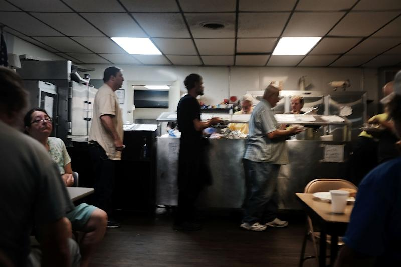 "People wait for lunch at a soup kitchen in Clarksburg, West Virginia; Philip Alston, the UN Special Rapporteur on extreme poverty and human rights said the US administration should be ""ashamed"" of its poverty alleviation efforts"