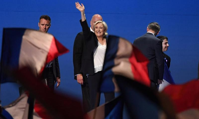 Marine Le Pen waves to supporters during an election rally