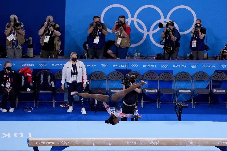 Simone Biles, of the United States, competes during the women's artistic gymnastics balance beam final at the 2020 Summer Olympics, Tuesday, Aug. 3, 2021, in Tokyo, Japan. (AP Photo/Morry Gash)