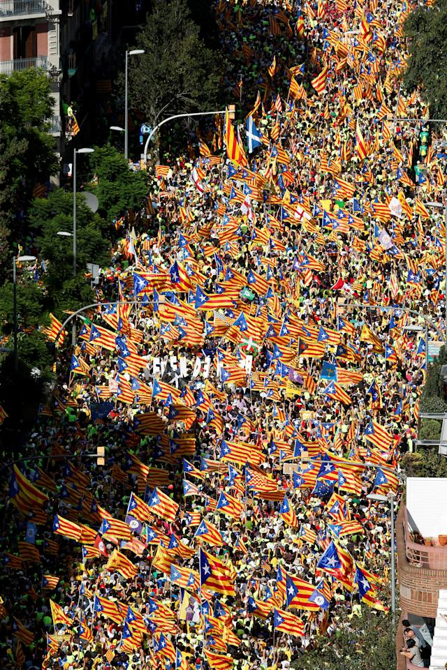 <p>Estelada (Catalan separatist flags) are waved as thousands of people gather for a rally on Catalonia's national day 'La Diada' in Barcelona, Spain, Sept. 11, 2017. (Photo: Albert Gea/Reuters) </p>