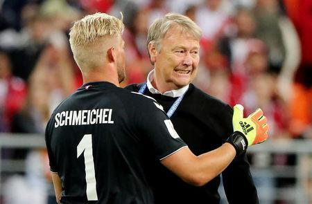 Soccer Football - World Cup - Group C - Peru vs Denmark - Mordovia Arena, Saransk, Russia - June 16, 2018 Denmark's Kasper Schmeichel celebrates with coach Age Hareide after the match REUTERS/Marcos Brindicci