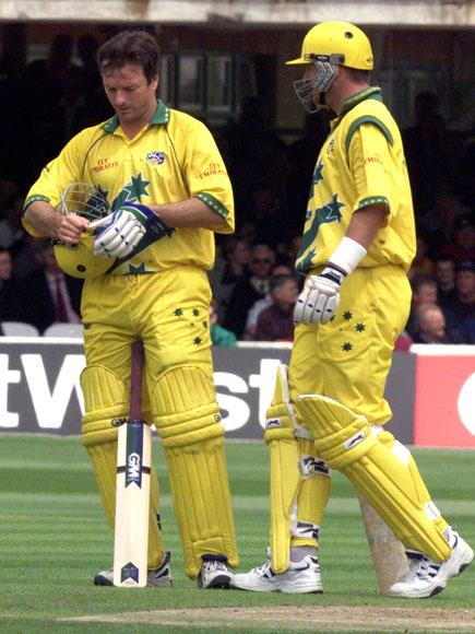 Australia`s captain Steve Waugh checks his helmet after being hit on the head by his brother Mark`s (R) drive during the Australian innings in the match between Zimbabwe v Australia in the Cricket World Cup match at Lords 09 June1999.  MARTYN HAYHOW/AFP/Getty Images