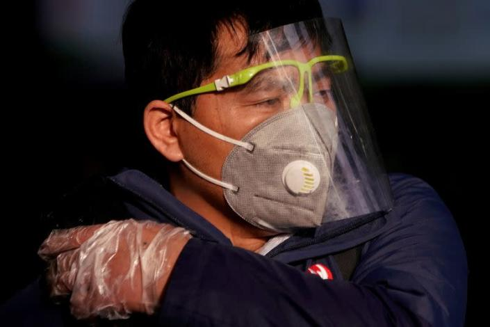 FILE PHOTO: A man wearing a mask is seen at the Shanghai railway station in Shanghai