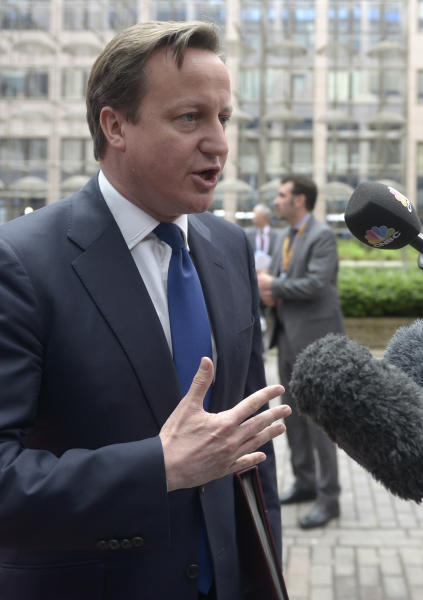British Prime Minister David Cameron addresses the media upon arrival at an EU summit in Brussels on Wednesday, May 22, 2013. Leaders from the 27 European Union countries gather in Brussels for one of their regular European Council sessions. On the agenda is the increasingly controversial subject of tax evasion. Countries such as Austria and Luxembourg which have lucrative, and somewhat opaque, banking systems have begun to fight back against efforts to improve the transparency of the EU's financial system.(AP Photo/Ezequiel Scagnetti)