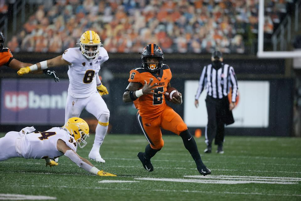 Oregon State running back Jermar Jefferson carries the ball against Arizona State on Dec. 19, 2020 in Corvallis, Ore.