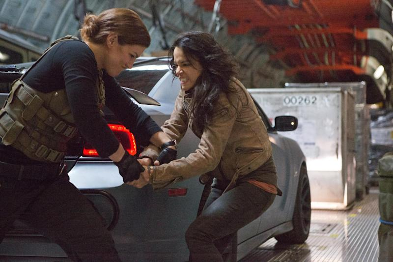 "This film publicity image released by Universal Pictures shows Gina Carano, left, and Michelle Rodriguez in a scene from ""Fast & Furious 6."" (AP Photo/Universal Pictures, Giles Keyte)"