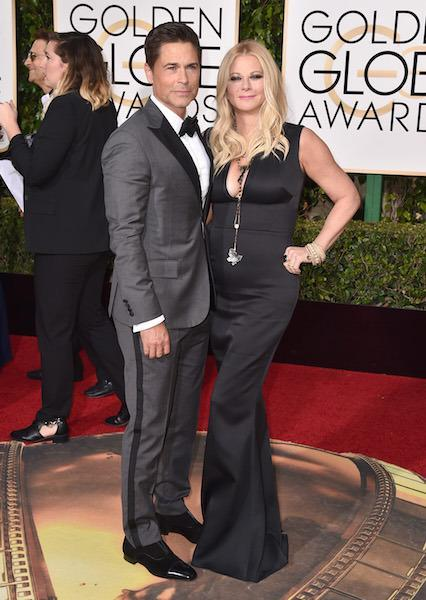 Rob Lowe in a gray and black tuxedo at the 73rd Golden Globe Awards.