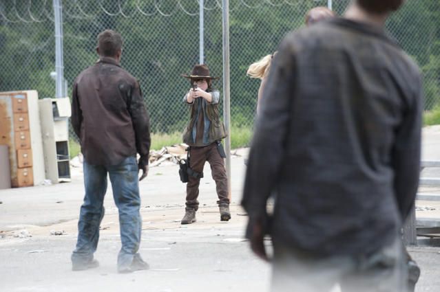 "Carl Grimes (Chandler Riggs) and walkers in ""The Walking Dead"" episode, ""Killer Within."""