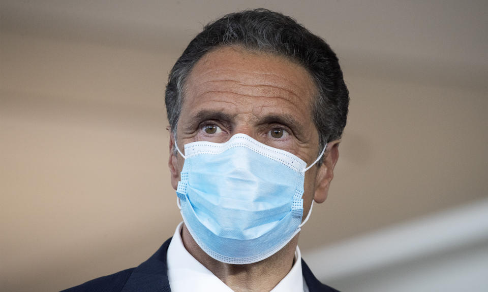 Gov. Andrew Cuomo wears a mask during a news conference at Laguardia Airport's Terminal B, Wednesday, June 10, 2020 in New York. The new terminal will open Saturday, June 13. (AP Photo/Mark Lennihan)