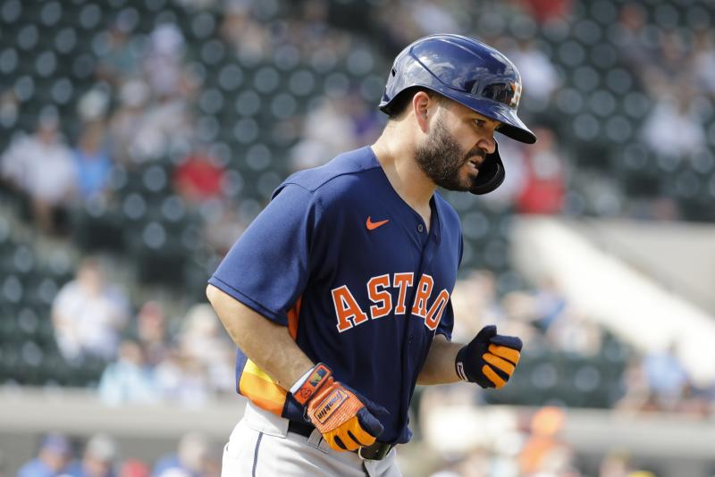 Houston Astros' Jose Altuve runs to first base after getting hit with a pitch during the fifth inning of a spring training baseball game against the Detroit Tigers, Monday, Feb. 24, 2020, in Lakeland, Fla. (AP Photo/Frank Franklin II)