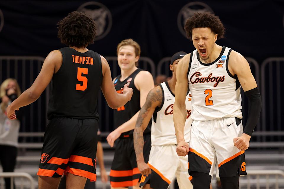 Cade Cunningham yells and flexes in reaction to a shot.