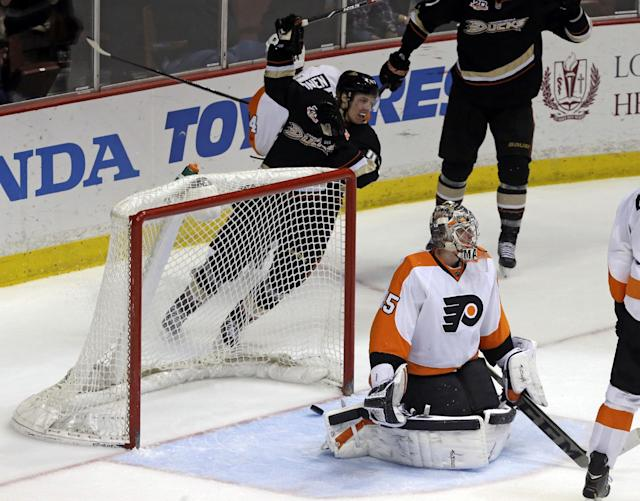 Anaheim Ducks defenseman Hampus Lindholm (47), of Sweden, rear, celebrates a goal by Corey Perry, not shown, against Philadelphia Flyers goalie Steve Mason (35) in the second period of an NHL hockey game in Anaheim, Calif., Thursday, Jan. 30, 2014. (AP Photo)